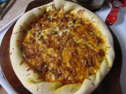 BBQ Chicken, sauted onions and sweet peppers make this a delicious and very filling pizza